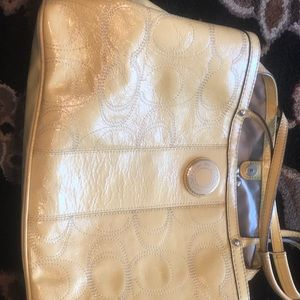 Yellow coach purse and clutch